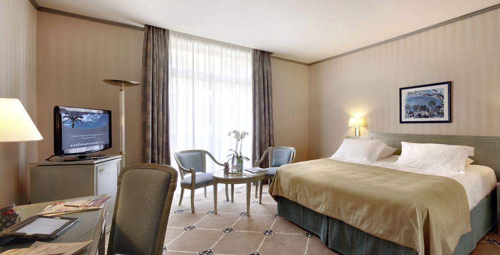Ein Deluxe Zimmer mit Stadtblick wartet auf Sie