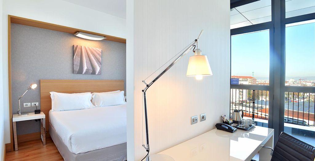 Te alojarás en una confortable habitación Deluxe