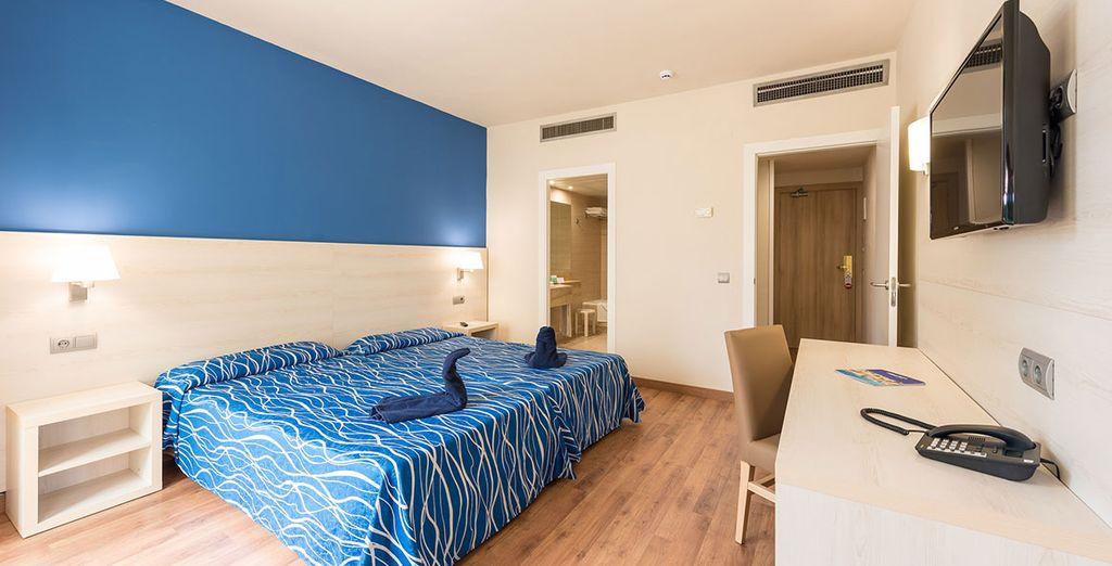 Descansarás en una de sus confortables habitaciones