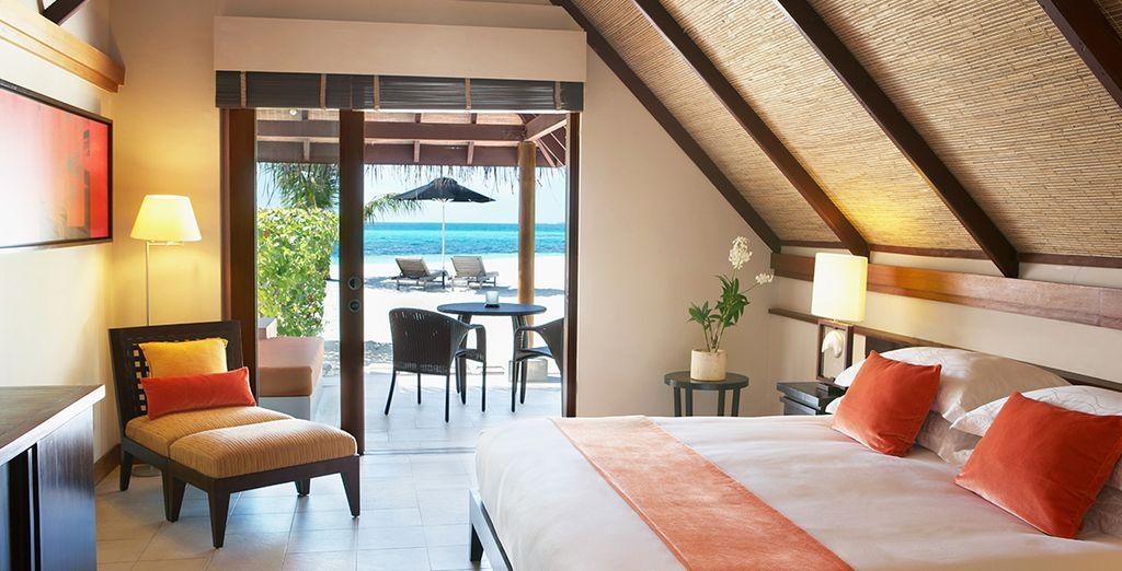 Chambre double confortable aux Maldives au cœur d'un hôtel de prestige, avec vue sur les plages de sable fin