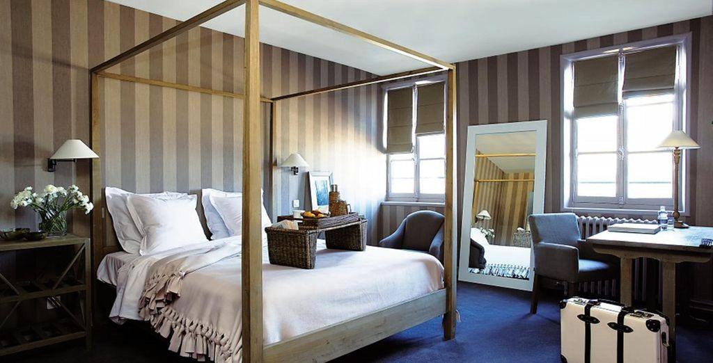 La chambre Prestige dispose d'un beau lit à baldaquin