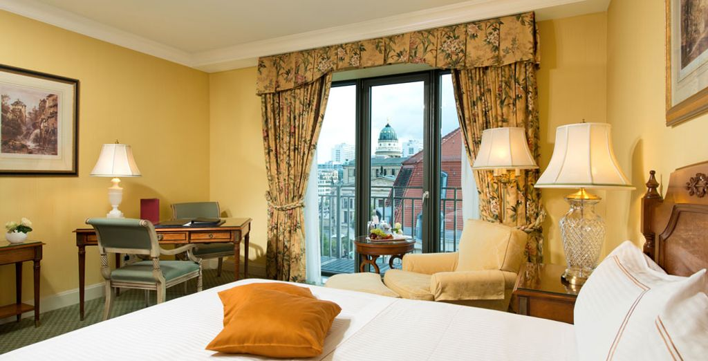 These rooms are a beautiful haven of comfort and restfulness (pictured: Deluxe Room)