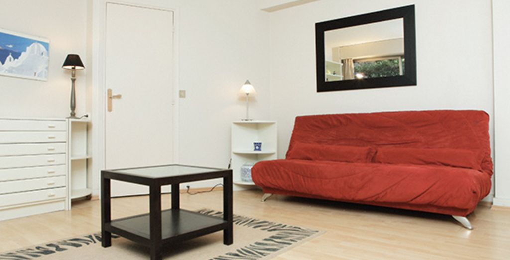 A living area with double sofa bed
