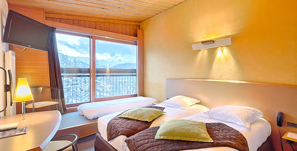 Your Superior Room features warm decor and is bathed in sunlight with its south facing window