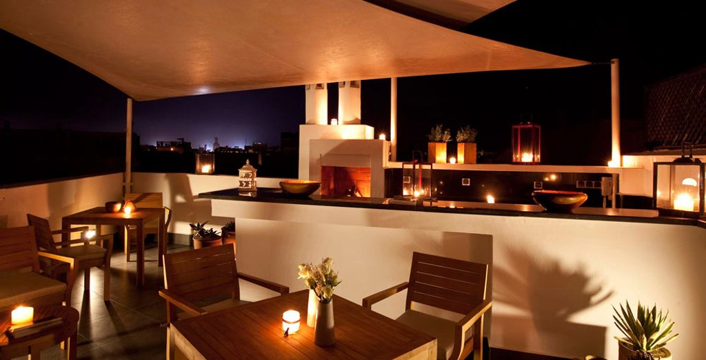 At night, enjoy your meal outside in this ravishing setting