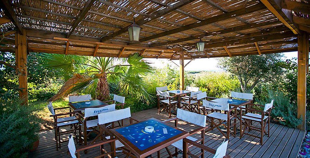Or perhaps seek some shade under the thatched roof terrace