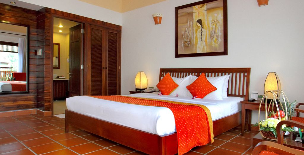 In a stylish Deluxe Room (pictured: Palm Garden Resort)