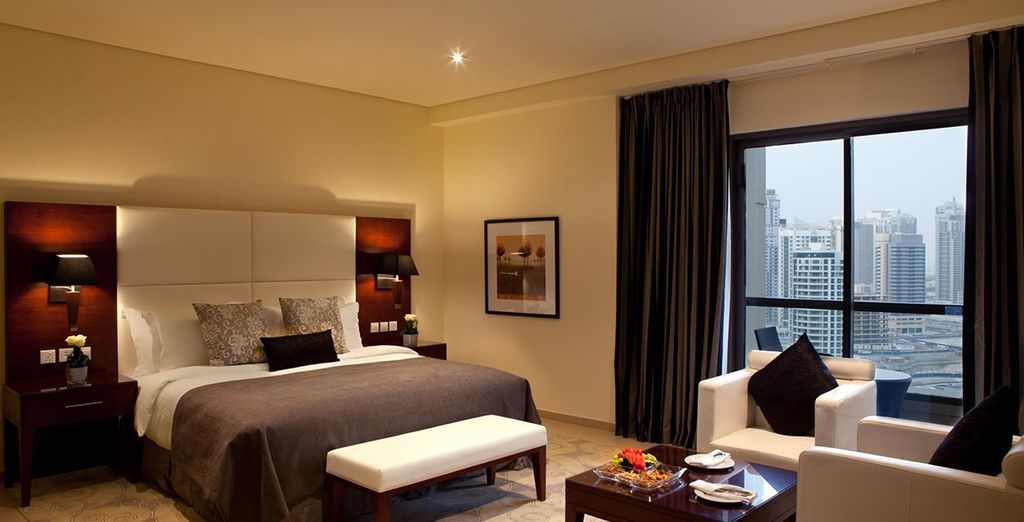 Stay in stylishly modern studio with a commanding view of the city