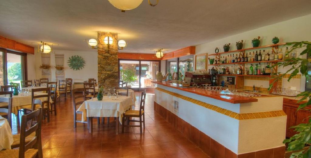 Discover the delights of Sardinian cuisine with your half board stay
