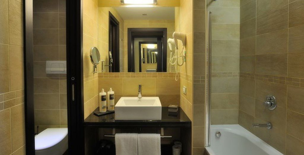 And features a luxurious bathroom and spacious patio