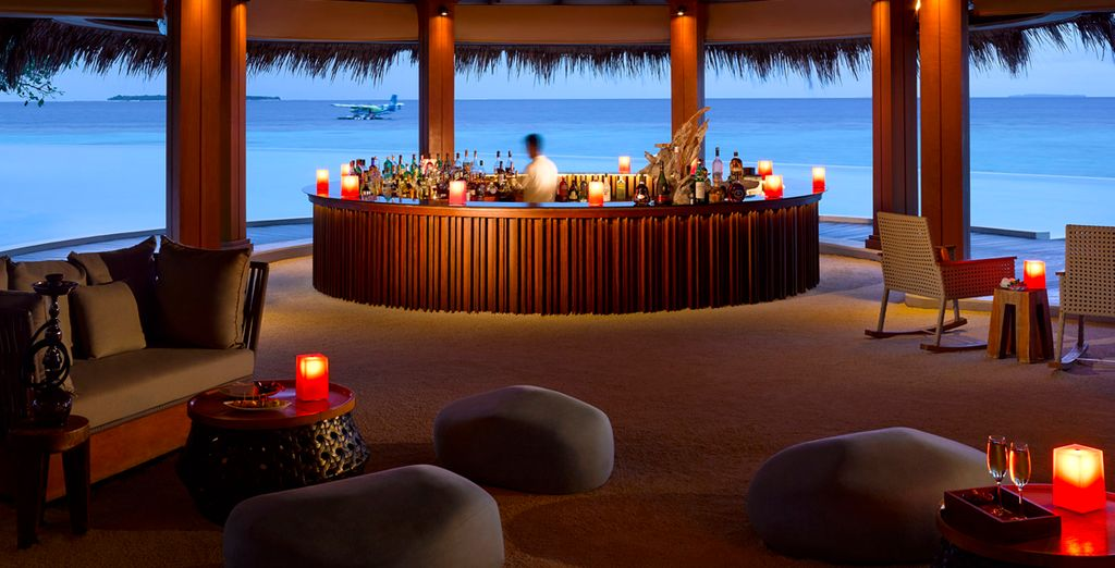 Order a cocktail at the beachside bar