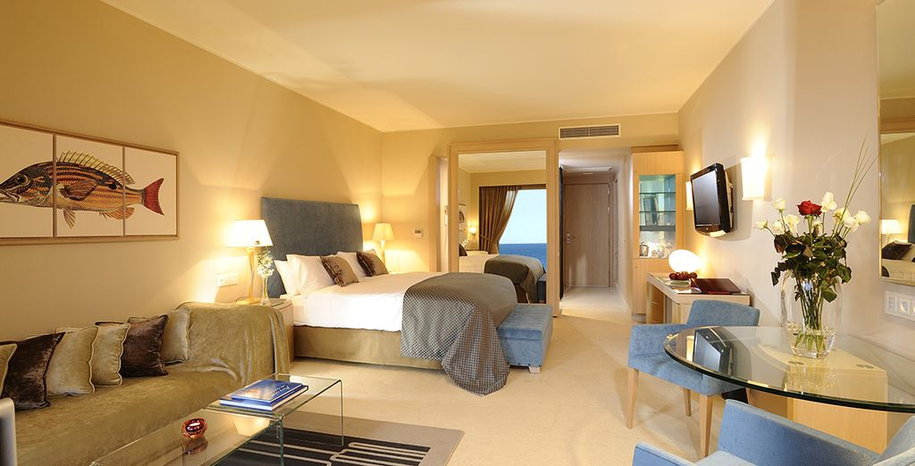 Relax and enjoy your stay in a Promo Deluxe Room with Sea View