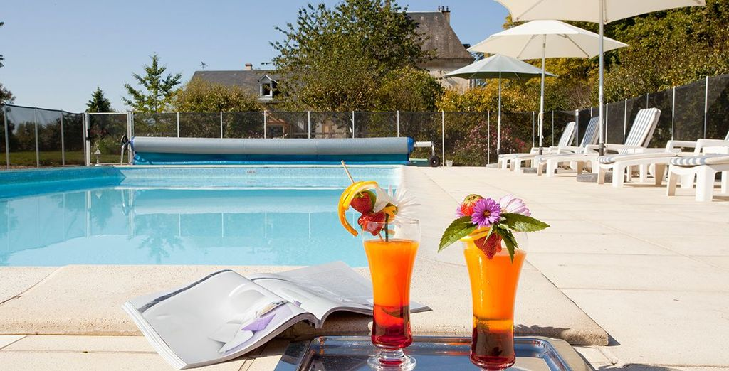 On a warm day, sip on a cocktail by the swimming pool