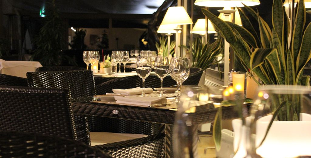 Sample the local gastronomy in the hotel's own restaurant