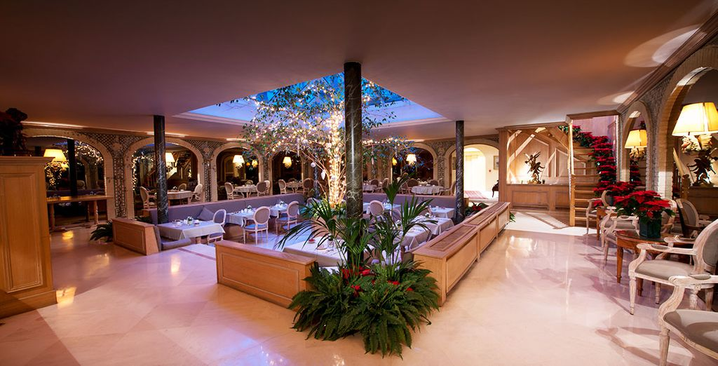 Enjoy fine dining in the restaurant at the Manos Premier Hotel, enveloped by magical gardens