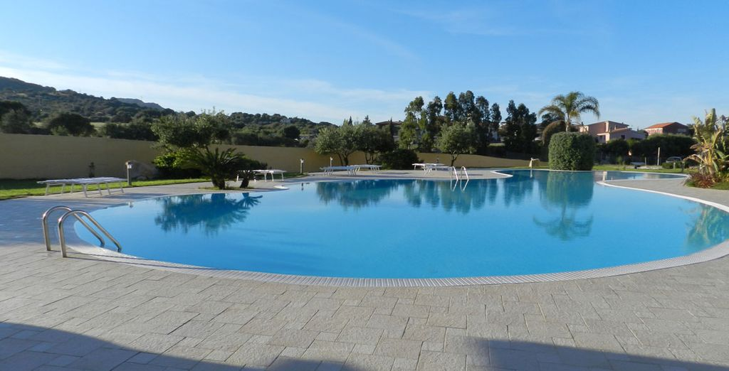Soak up the sun as you relax by the pool