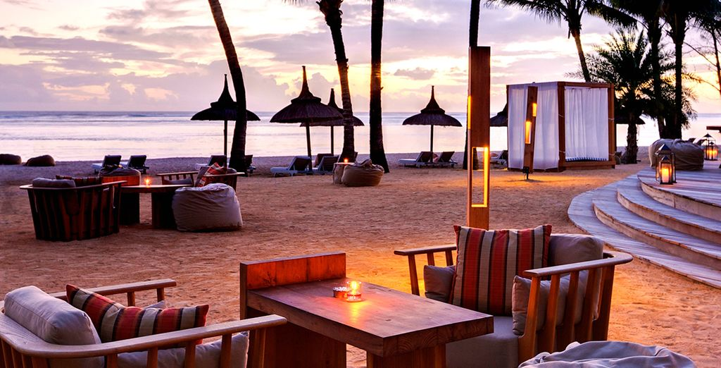 Savour candlelit drinks by the sea