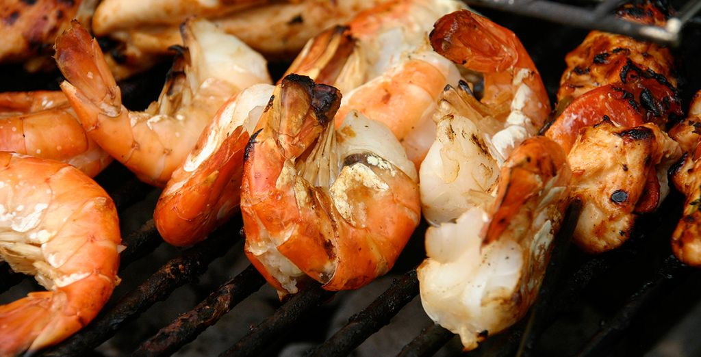 Dine on the beach and enjoy a delicious seafood BBQ