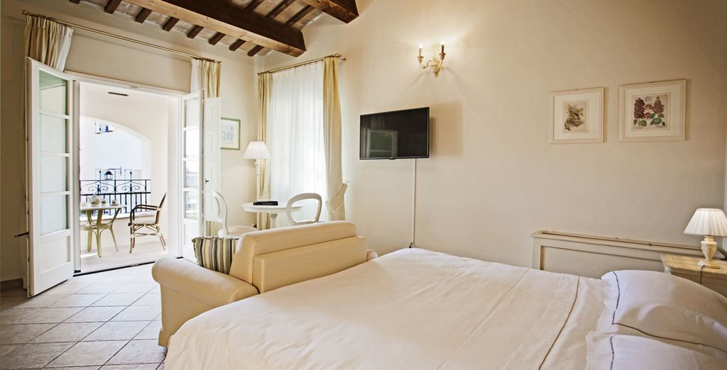 Sleep in a spacious Junior Suite overlooking the vineyards, complete with a balcony