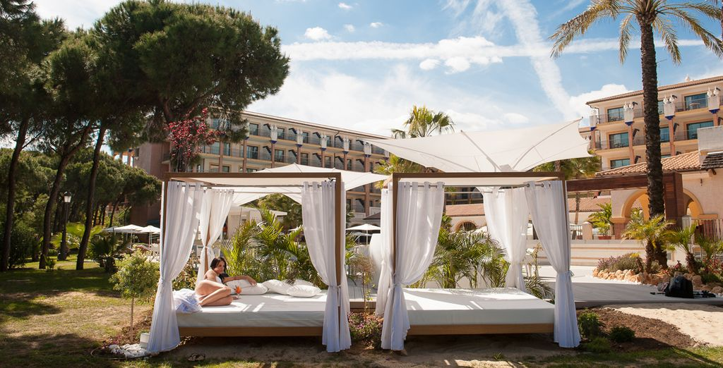 Chic Balinese beds are dotted about for sunbathing and relaxing...