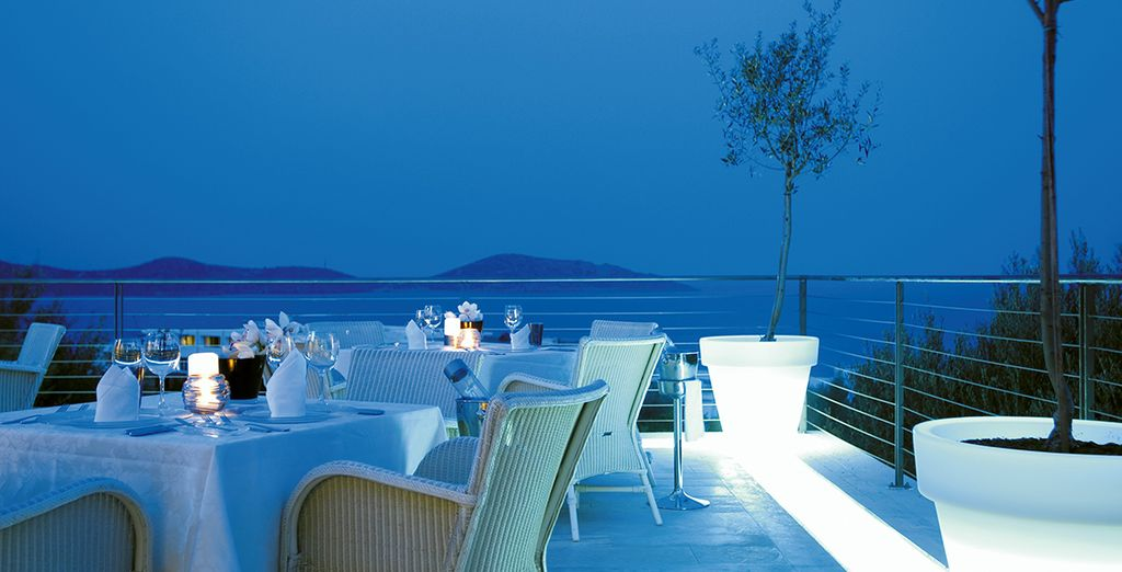 Dine by candlelight overlooking the Mediterranean