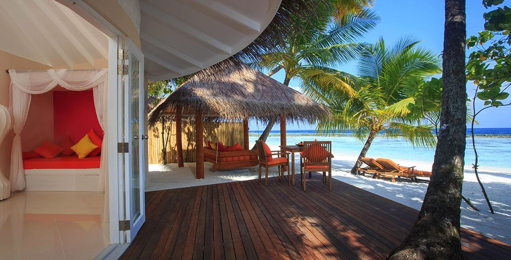 You can step right out onto the soft sand from your Beach Villa