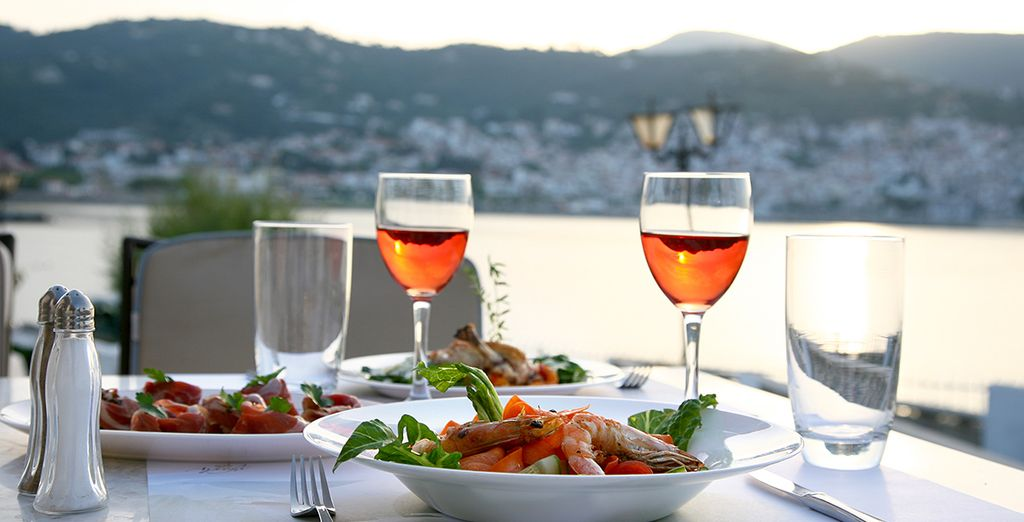 As the sun sets, feast on local seafood and wine