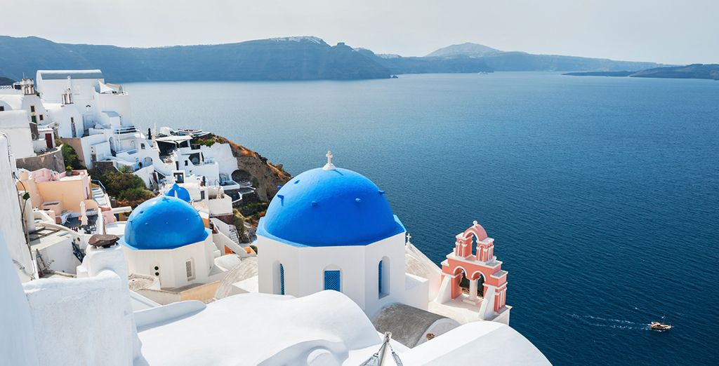 Explore Santorini's iconic architecutre, with its blue roofed churches and white structures