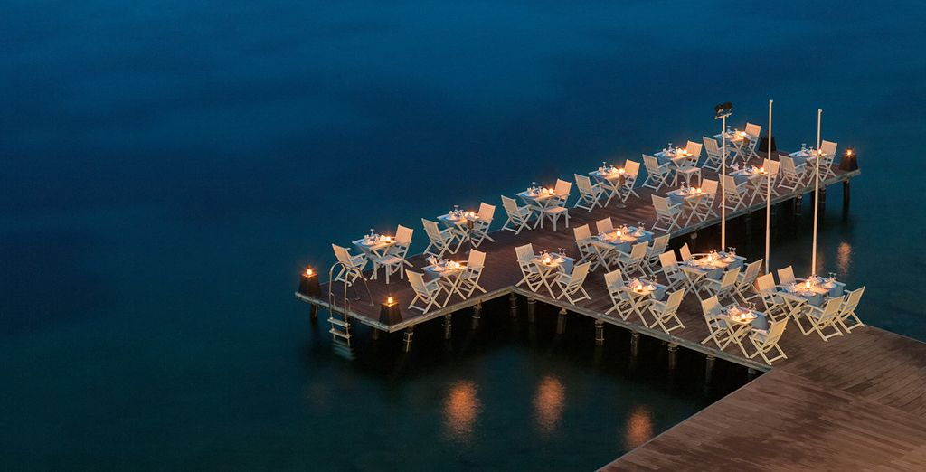 Finish up with a romantic candlelit dinner perched above the calm Mediterranean
