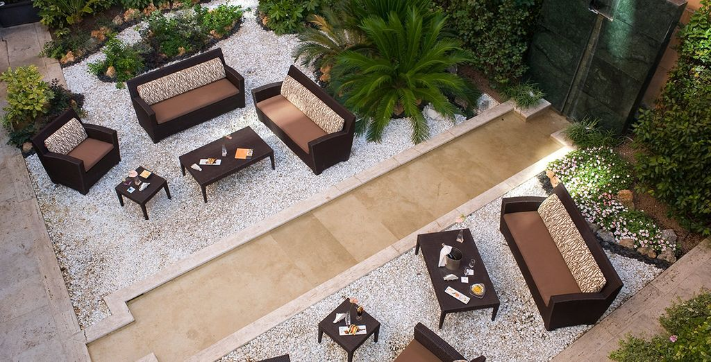 Sip a glass of wine out in the courtyard
