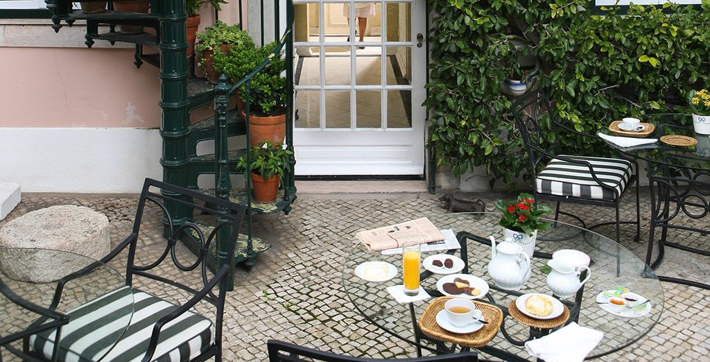 In the warmer months, enjoy breakfast in the pretty courtyard garden