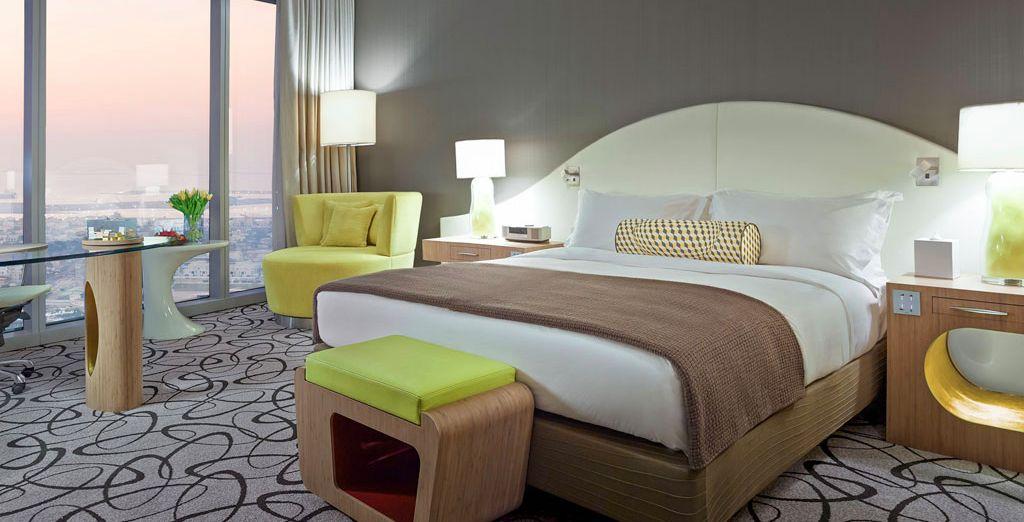 Sleep in an upgraded Premium Luxury Room with views of the Burj Khalifa