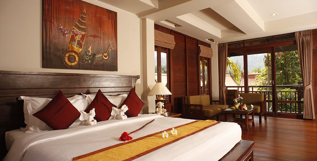 Designed with rich Thai fabrics and mural paintings