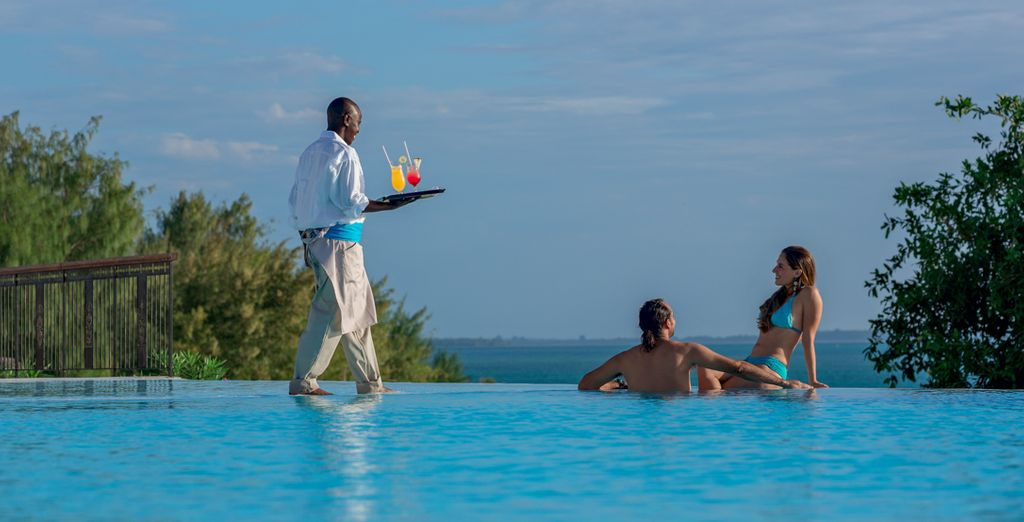 Soak up the sunshine by the infinity pool