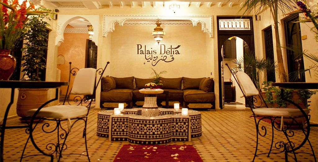 Relax in a pretty courtyard at a traditional riad