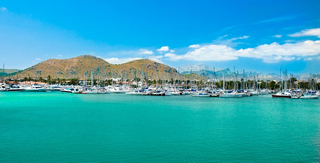 Stroll down to the fishing harbour and take in the picturesque Alcudia Bay