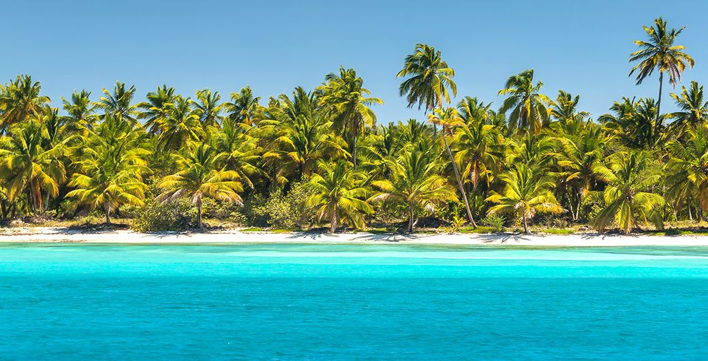 Soft white sands and swaying coconut trees will greet you