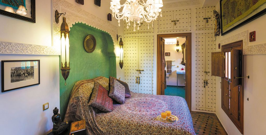 Deluxe Rooms are decorated in typically bright jewel tones