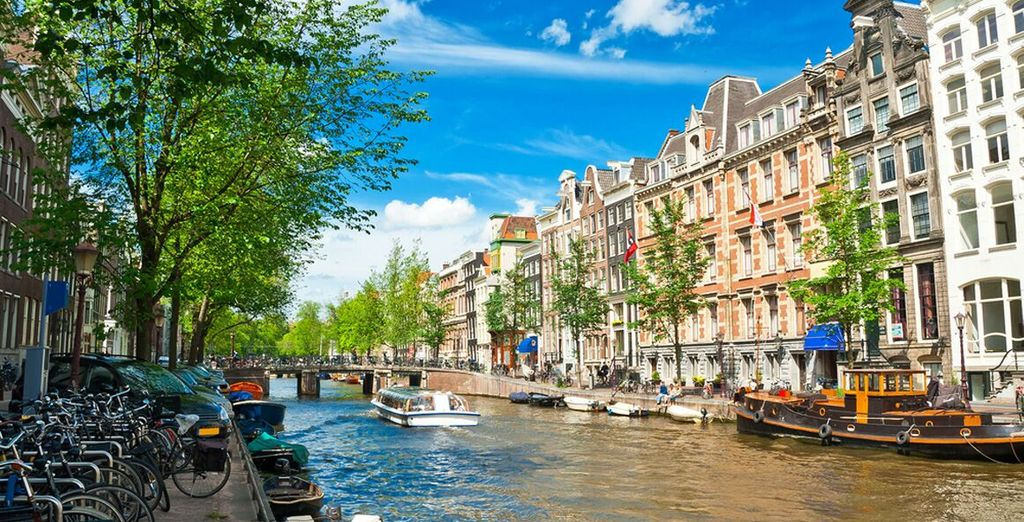 Glide down the charming canals of Amsterdam