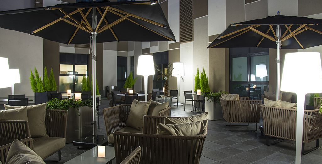 Kick back on the hotel's patio upon your return