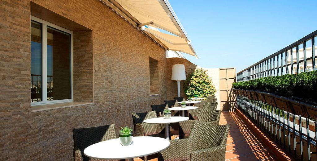 Enjoy a drink on the sun-dappled terrace