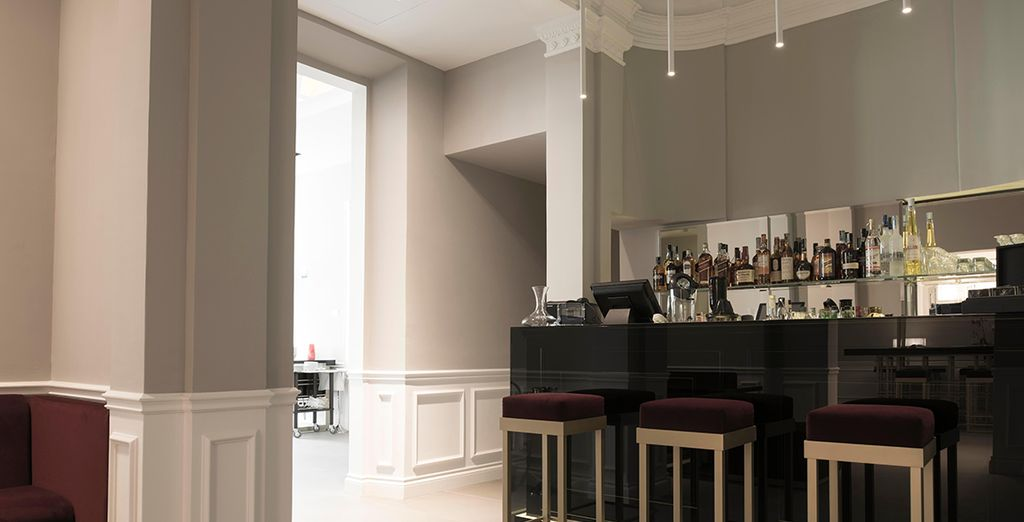 Order a drink at the chic bar