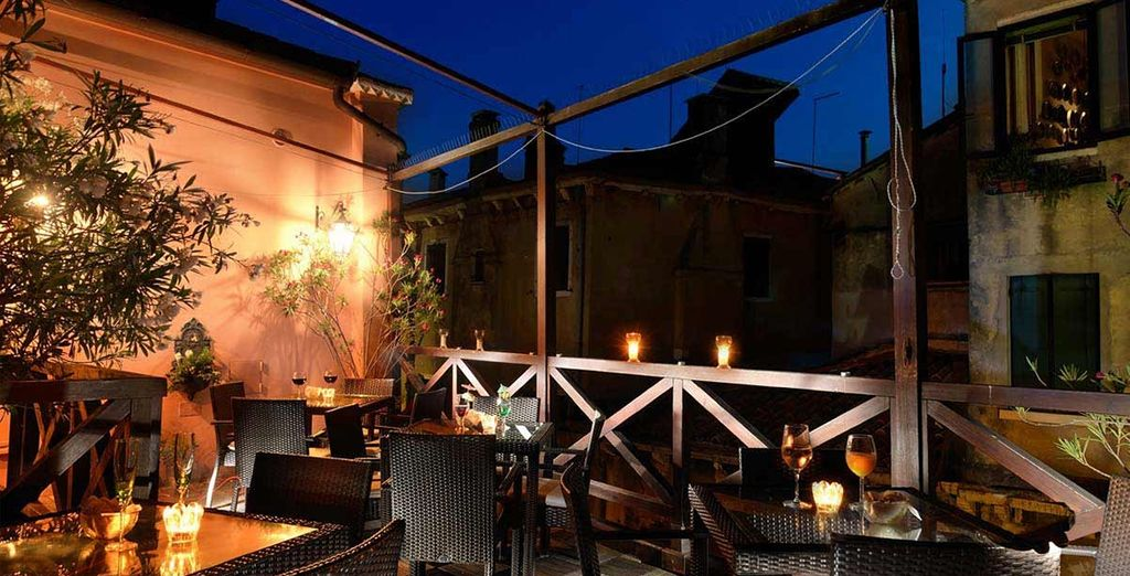 The softly-lit terrace is the perfect place to end the day