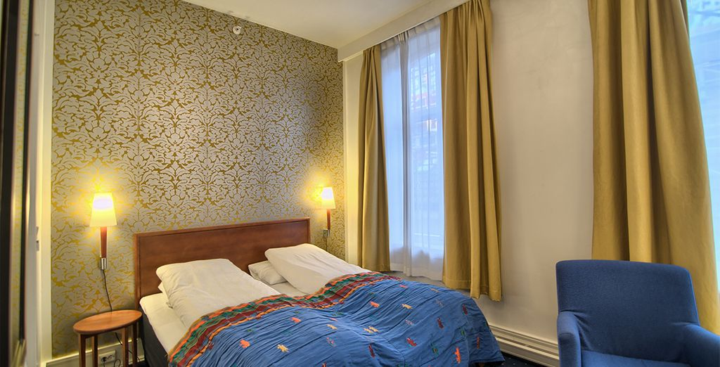 Stay in comfortable and elegant rooms (Augustin Hotel)