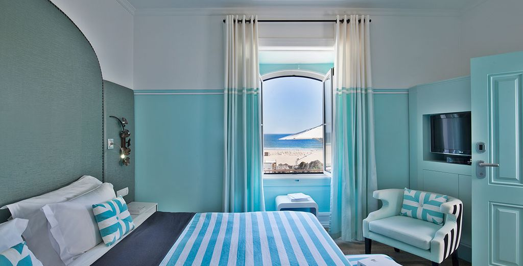 Stay in an Elegance Room with a side sea view