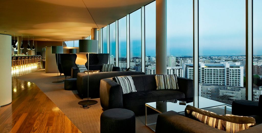 Lounge on the comfortable sofas while taking in panoramic the city views