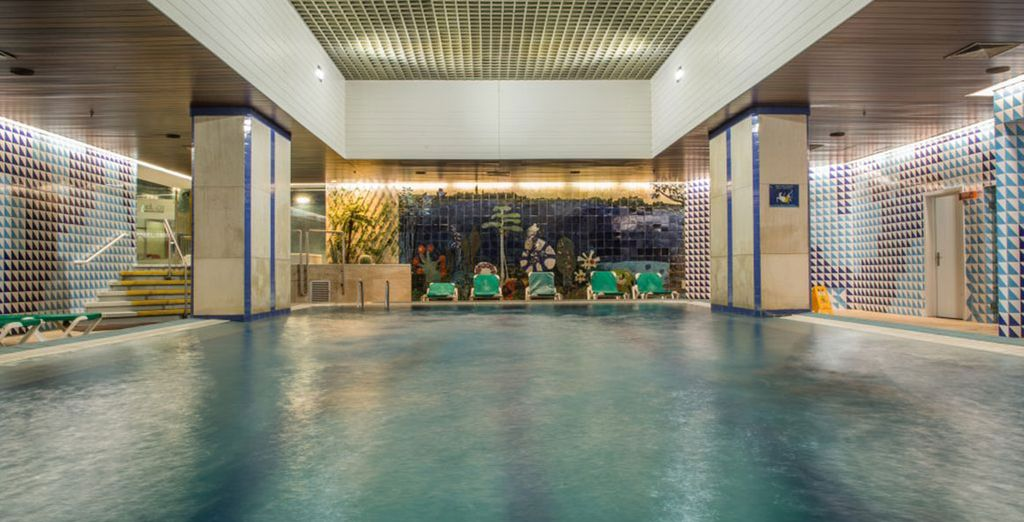 Treat yourself to a refreshing dip in the serene indoor pool