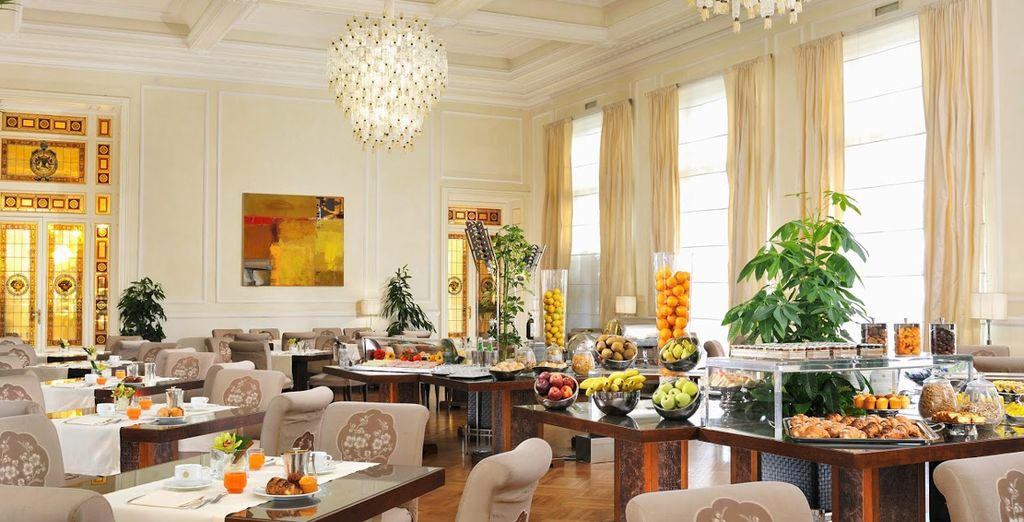 Wake up to breakfast under the chandelier
