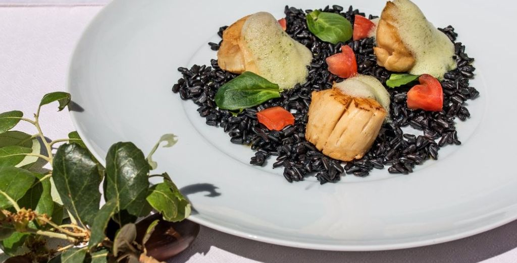 Dine at the hotel's restaurant serving traditional cuisine...