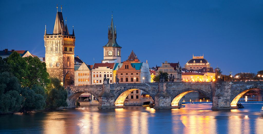 Visit the famous Charles Bridge in Prague, Czech Republic